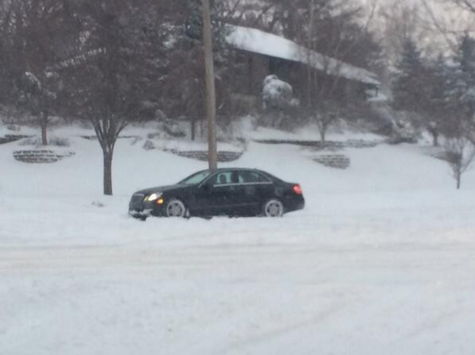 This car was stuck in the snow on Shelburne Road for more than five minutes during the morning of Feb. 18. Hutchings did not cancel school that Tuesday in part because of the high school's delayed start.