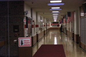 "Flags of various countries line the walls of the middle school's ""cycle"" hallway."