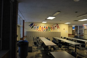 A mural listing the ten IB learner attributes overlooks the middle school cafeteria.
