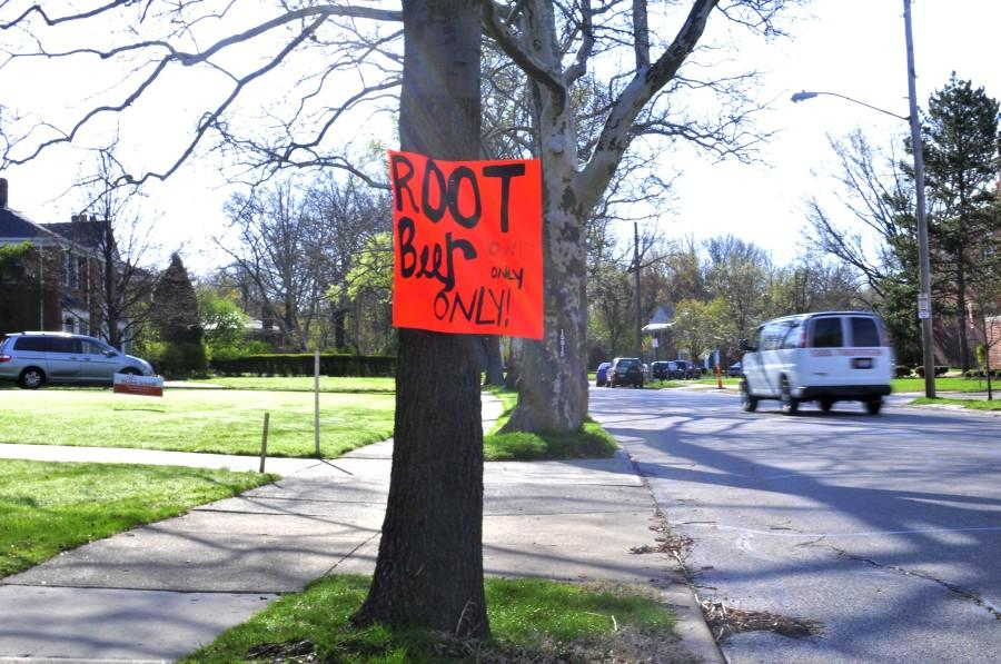 "A sign titled ""Root beer only, only"" tells bystanders and the high school that the senior prank, representing a college fraternity party does not feature alcohol May 5, 2014. The prank was set up in a vacant lot across from the North Gym parking lot. The lot is owned by Shaker parents."