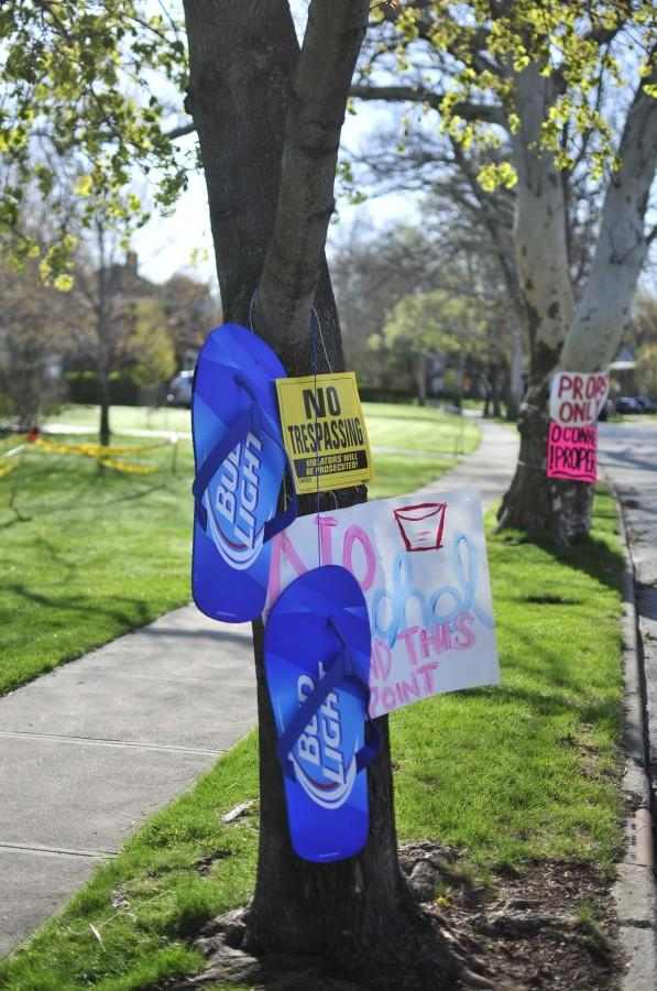Signs posted on trees beside Onaway Road tell passersby that the senior prank does not involve alcohol May 5, 2014.