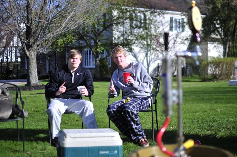 Seniors Jacob Herbst and Nick Adamson pose for a picture next to a keg filled with root beer May 5, 2014.